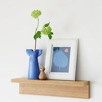 リサ・ラーソンのワードローブをモチーフにした花瓶で、花との暮らしを楽しんで