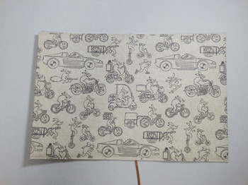 <布と紙の文庫本カバー「戯画車輪」>  不織布と紙で出来ている一風変わった文庫本カバー。表面には、鳥獣戯画現代版「自転車&宅配ミックス」という、レトロなうさぎさんが色んな乗り物に乗っているテキスタイルが!