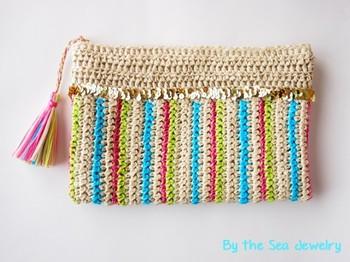 「By the Sea Jewel」はジュエリー作家さん。ハンドメイドの麻のクラッチバッグです。ゴールドスパンコールのアクセントが元気をくれます♪