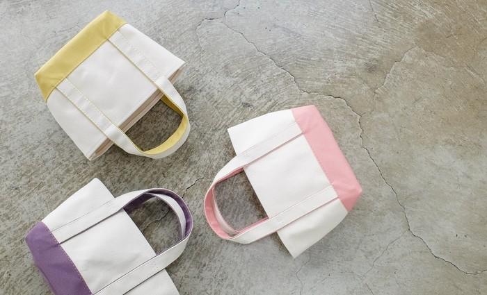 """明るくカラフルなトートバッグ。厚手の6号帆布をベースに、底と持ち手の裏側はカラーの8号帆布を使用しています。Classicsシリーズにも、パラフィン加工の9号帆布""""Light""""タイプがあります。"""