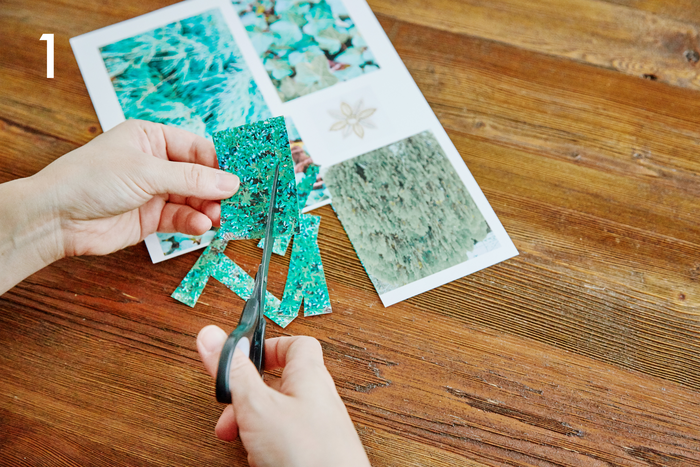Aの用紙をはさみで横長にカットします。きれいに切るのではなくザクザクとランダムにカットするのがポイント!Bの用紙は形に添って使用する素材をカットします