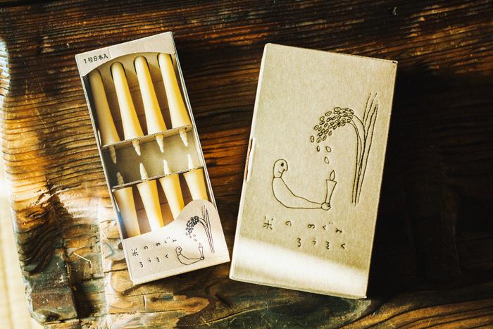 「米のめぐみろうそく」。「菜の花ろうそく」と同様、絵本作家・太田朋さんのイラストが描かれています