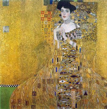 """金箔をふんだんに使用した煌びやかな作品、「アデーレ・ブロッホ=バウアーの肖像 I」。「接吻」と同じく1907年に制作されたもので、この時期の作品には金箔が多用されていることから""""黄金の時代""""とも呼ばれています。"""