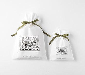 ちょっとしたプレゼントには無料のラッピングもおすすめ。テネリータのブランドロゴがポイントの巾着袋にグリーンのリボンが素敵なアクセントに。