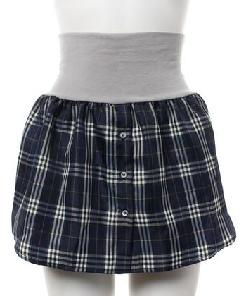 """こちら、スカートじゃないんです。腹巻きにシャツの裾がくっついたアイテム。短め丈のトップスに合わせて""""なんちゃってシャツ""""を楽しんでみてはいかがですか?"""
