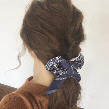 シンプルに髪に結んでリボン代わりに使ってもOK。