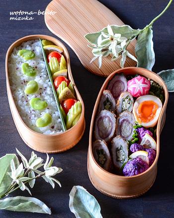 豆のような形の2段弁当。豆の形を生かして、ご飯の上に豆を乗っけるというアイディアが面白いですね。主菜の肉巻きも彩の良い野菜を使うことで、おしゃれに楽しめるのがポイント。