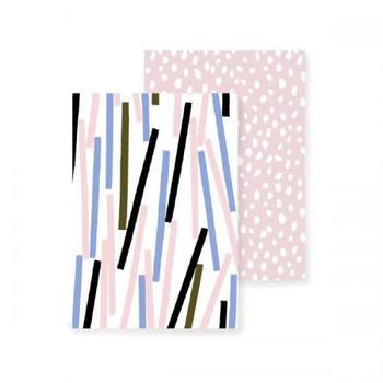 こちらは紙吹雪をモチーフにした「コンフェッティ」。どちらも、ちょっといびつなピンクのドット模様のノートと2冊セットになっています。
