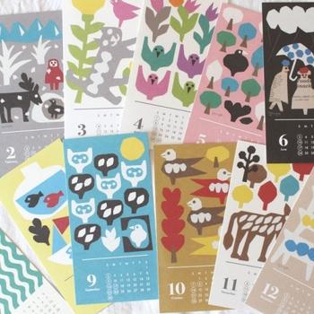 切り絵作家YUYAさんによる、四季折々のモチーフが描かれたカレンダーは、カレンダー部分を切り取ると、ポストカードとしても使える嬉しい仕様!キレイな色使いのカレンダーは、眺めているだけで心がウキウキしてきますね。
