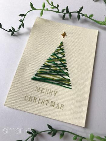 紙刺繍でクリスマスツリーを描いたカード。シンプルでありながらぬくもりも感じられますね。