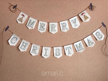 シンプルでおしゃれなクリスマスの壁飾りにおすすめしたい紙刺繍のガーランド。布にする刺繍とは違った味わいで、おしゃれに壁をデコレーションしてみましょう♪