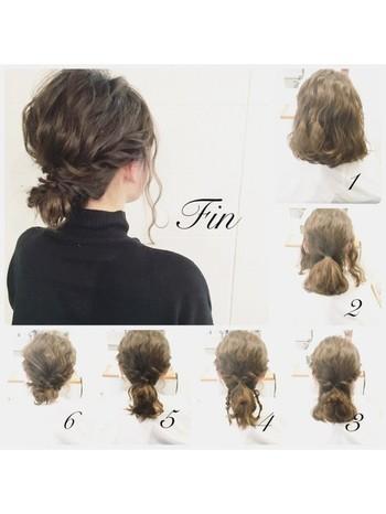 両サイドの髪を多めに残してローポニーを作り、それぞれねじって、最後にローポニーをくるんと丸めてピンで留めたら完成!ボブなのにロングのようなまとめ髪が新鮮です♪