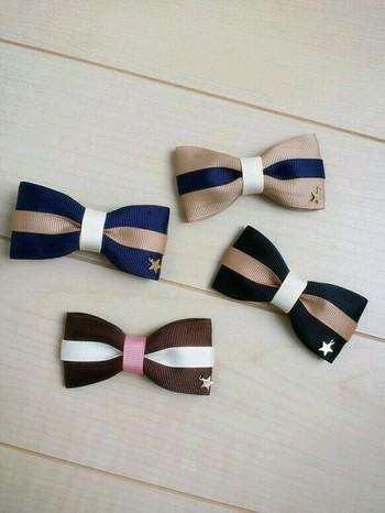星のチャームが付いたベビー&キッズ向けの蝶ネクタイ。お子様のフォーマルなファッションの時に活躍しそうですね♪