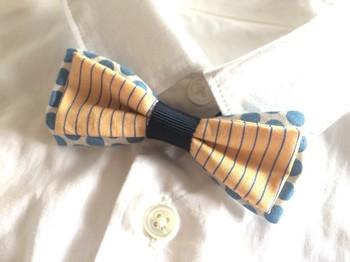 ドット柄とボーダーの2つの柄を組み合わせて、個性豊かなデザインに仕上げた蝶ネクタイ。自分だけのオリジナル感を出せるのが手作りの魅力です。