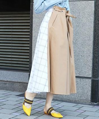 「AMERI VINTAGE(アメリヴィンテージ)」のスカートは、リボンでキュッと絞って着られるボックスプリーツスタイルと、チェック柄スタイルの2way仕様。