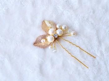 ゴールドリーフとパールのかんざしは繊細な美しさ。ほどよい華やかさで、目立ち過ぎずないので使いやすい◎