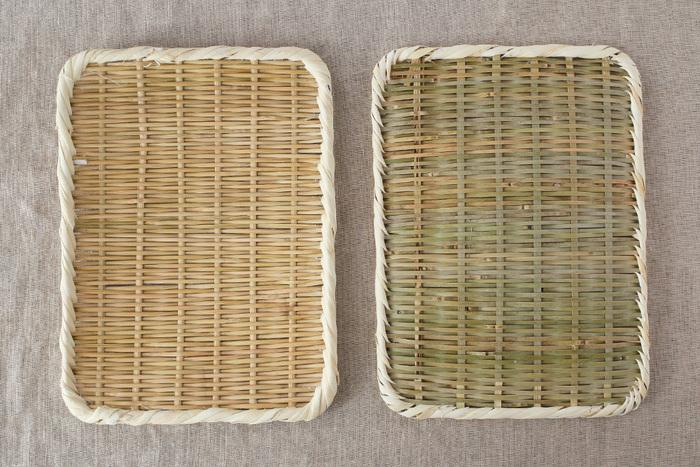 """比較的フラットで長方形の""""真竹角盆ざる""""は、新潟の職人さんの手作り。水の膜ができにくい竹は清潔で、食べ物を扱うのに適しています。割れる心配もなく軽いので、扱いやすいんです。"""