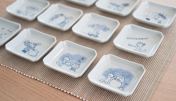 絵本でおなじみの「11ぴきのねこ」。動物たちの12ヶ月が、12枚の豆皿になって登場しました。印判染付で描かれたねこのイラストを長崎県波佐見町の釜で焼き上げたという、東屋こだわりの豆皿です。