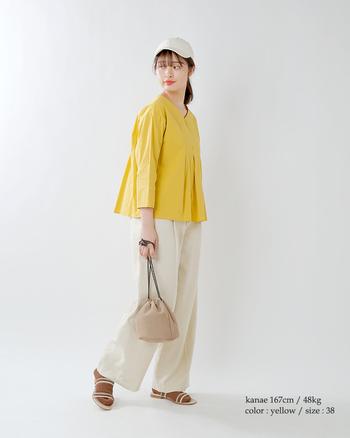ミモザみたいなかわいい黄色は、これからの季節にも重宝するカラーです。白の柔らかさを活かして女性らしく仕上がります。