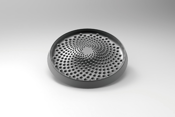 裏側には突起物が配置され、蒸気調理の大事な役割を担っています。突起物によって蒸気を水滴に循環させることで、食材の水分のみで調理する無水調理を可能にしています。