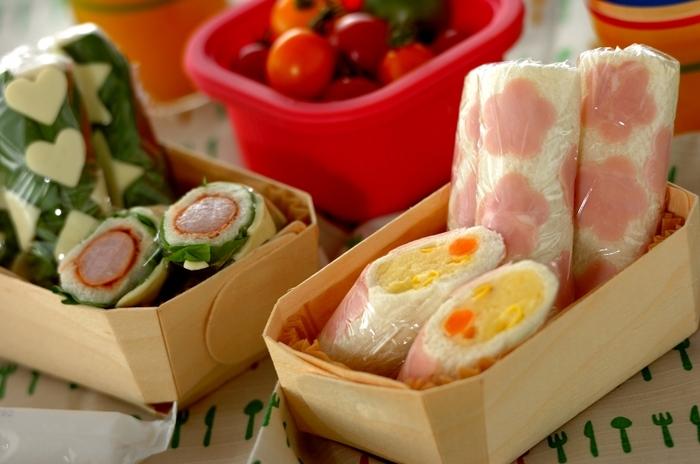 食パンのサンドイッチでは、ロールサンドもおすすめのひとつ。食べやすくキュートな見た目も魅力です。こちらは、型抜きしたハムやチーズ、サラダ菜などの具材を外側に置いて巻いたユニークなレシピ。ソーセージやポテトサラダなどの内側の具材の断面もアクセントになっています。