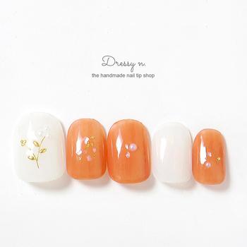 春トレンドは指先から!元気はつらつ『オレンジネイル』のデザイン集