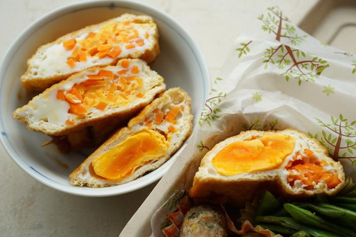 油揚げに卵と人参を詰め込んだ「巾着たまご人参」。細切りの人参のオレンジと卵の黄色でお弁当をかわいく彩ります。甘辛の食欲をそそる味付けです。