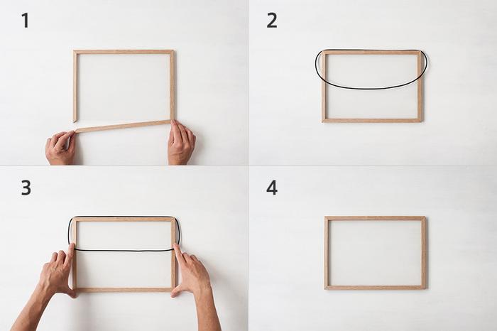 透明のアクリル板に挟めるものなら、少しくらいの厚みがあっても大丈夫。アクリル板にフレームを取り付けたら、ラバーバンドで固定して使います。