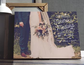 アンティーク調に加工した写真パネルに、デザインされた文字がおしゃれなウェルカムボードです。前撮り写真が、海外ウェディングのポスターのような一枚に。