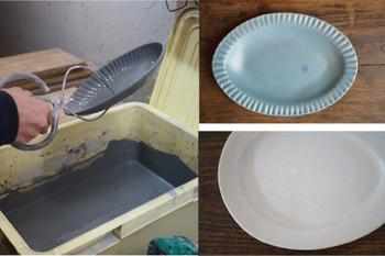 こちら(画像)が、「釉掛け」の作業。粉状の釉薬の原料を、水に溶いて液状にしたものに、うつわを浸したり塗ったりして、釉を施していきます。  釉薬をかけて本焼きをすると、釉薬が溶け、うつわの表面でガラス質に変化します。