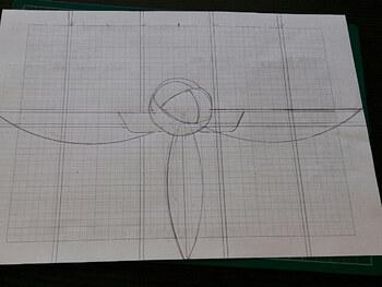 まずはデザインや図案を決め、紙に下絵を書いていきます。紙はフォトフレームに収まるサイズのものを使用しましょう。