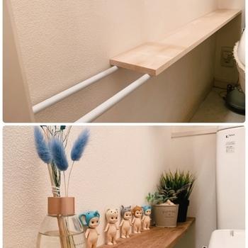 突っ張り棒2本と板があれば、簡単に棚を作ることができます。サイドに作って、グリーンやオブジェを飾るスペースに。