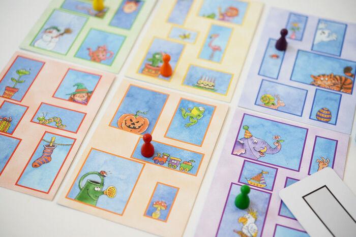 窓が並んだデザインがユニークな、その名も「窓ふき職人」。指示カードを引いて同じ窓(大きさ・形)を探すというドイツのカードゲームです。窓が見つかったら、一斉にコマを置いていて答え合わせ。カードの裏に正解の絵が描かれていて、正解した人がカードをもらえるというルールです。