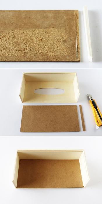 スライド式になっているティッシュケースの底板を外し、長方形の側面を一方だけ切り取ります。底板の持ち手部分は取り外し、ケースの内側と同サイズにカットします。